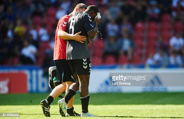 Jores Okore of AaB Aalborg leaving the pitch injured during the Danish Alka Superliga match between FC Copenhagen and AaB Aalborg at Telia Parken...