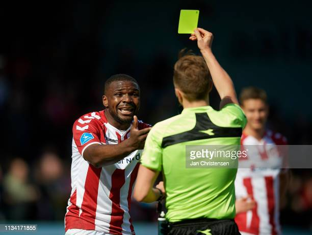 Jores Okore of AaB Aalborg receive a yellow card from referee Jakob Kehlet during the Danish Superliga match between AaB Aalborg and Randers FC at...
