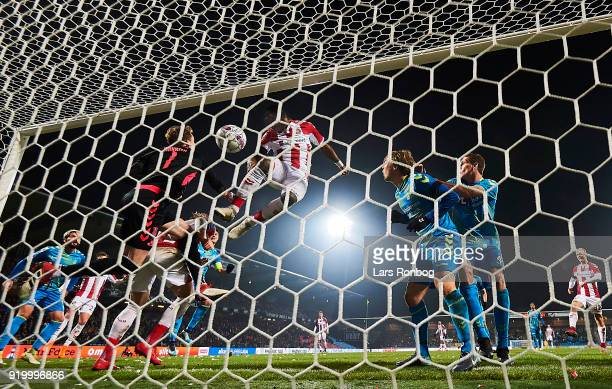 Jores Okore of AaB Aalborg scores the 11 goal against Goalkeeper Frederik Ronnow of Brondby IF during the Danish Alka Superliga match between AaB...