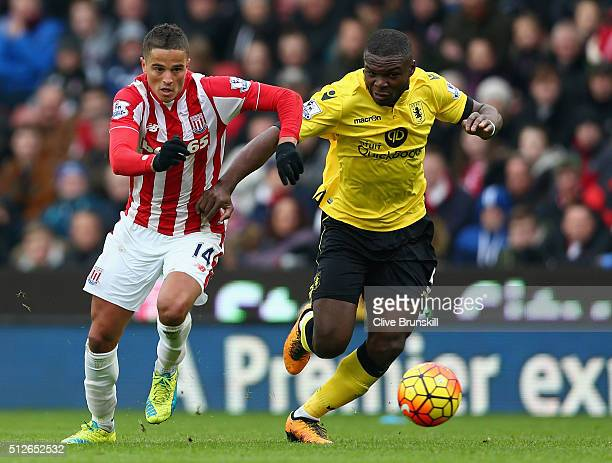 Jores Okore of Aston Villa and Ibrahim Afellay of Stoke City compete for the ball during the Barclays Premier League match between Stoke City and...