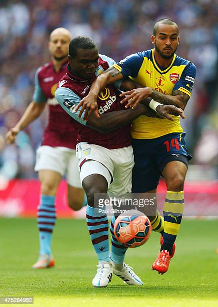 Jores Okore of Aston Villa and Theo Walcott of Arsenal battle for the ball during the FA Cup Final between Aston Villa and Arsenal at Wembley Stadium...