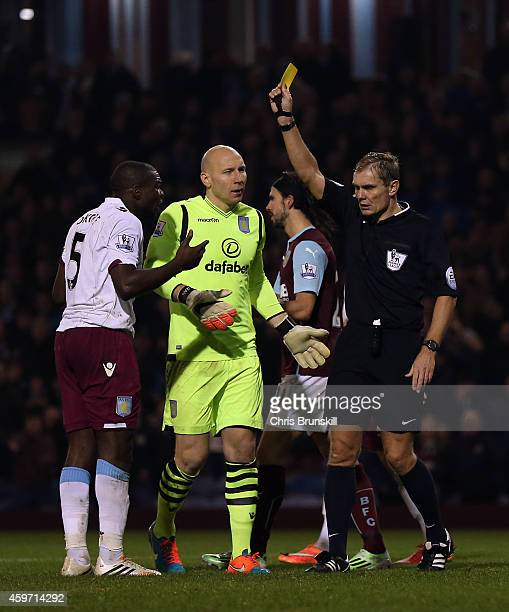 Jores Okore of Aston Villa is shown the yellow card by referee Graham Scott during the Barclays Premier League match between Burnley and Aston Villa...