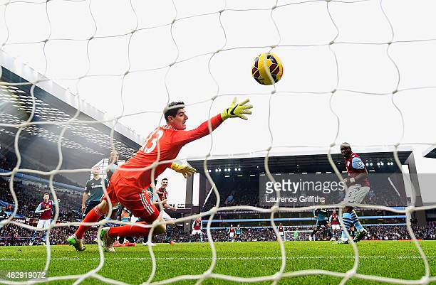 Jores Okore of Aston Villa scores a goal past Thibaut Courtois of Chelsea during the Barclays Premier League match between Aston Villa and Chelsea at...