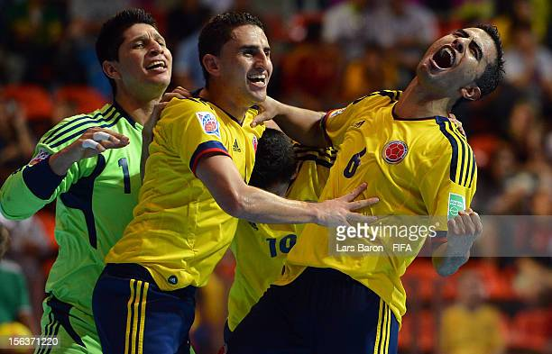 Jorge Abril of Colombia celebrates with team mates goalkeeper Juan Lozano and Miguel Sierra after scoring his teams third goal during the FIFA Futsal...