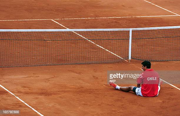 Jorge Aguilar reacts after losing a point during the Davis Cup quarterfinal doubles match against Jan Hajec and Lukas Dlouhy of Czech Republic in La...