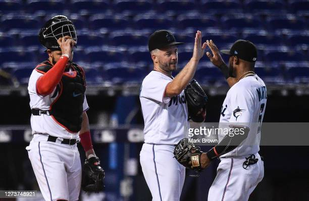 Jorge Alfaro, Brandon Kintzler, and Starling Marte of the Miami Marlins celebrate the win against the Washington Nationals by score of 2-1 at Marlins...