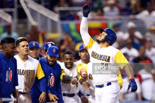 Jorge Alfaro of Team Colombia points to the sky as he crosses home plate after hitting a game tying home run in the eighth inning during Game 5 of...