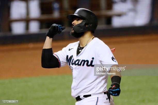 Jorge Alfaro of the Miami Marlins celebrates after hitting a two-run home run during the third inning against the Boston Red Sox at Marlins Park on...