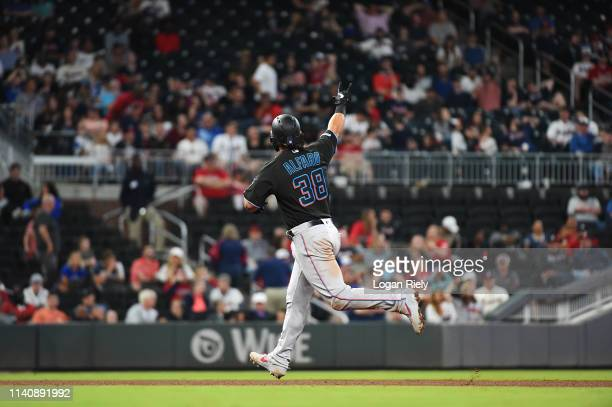 Jorge Alfaro of the Miami Marlins celebrates while rounding the bases after hitting a home run against the Atlanta Braves at SunTrust on April 06,...