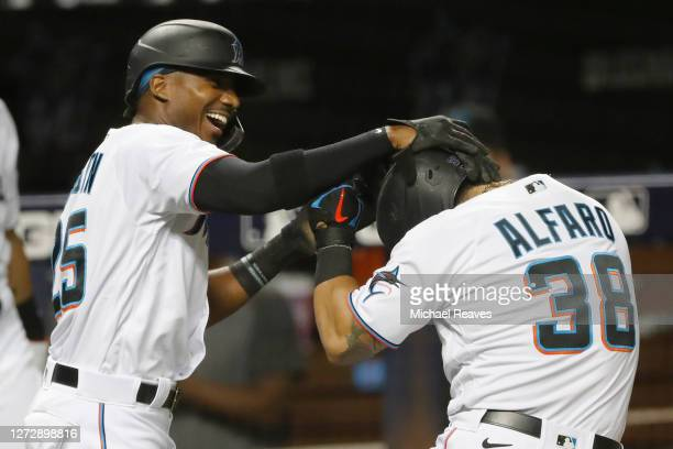 Jorge Alfaro of the Miami Marlins celebrates with Lewis Brinson after hitting a two-run home run during the third inning against the Boston Red Sox...