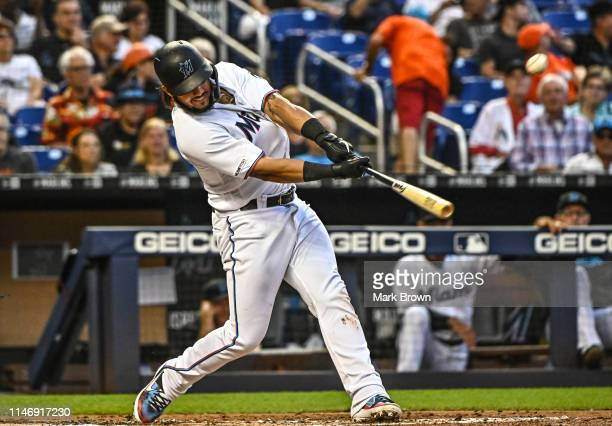Jorge Alfaro of the Miami Marlins doubles in the second inning against the San Francisco Giants at Marlins Park on May 29, 2019 in Miami, Florida.