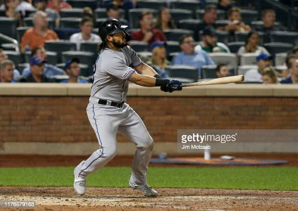 Jorge Alfaro of the Miami Marlins follows through on his sixth inning grand slam home run against the New York Mets at Citi Field on September 23,...