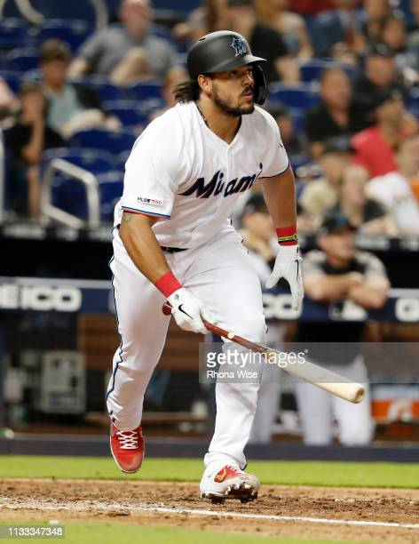 Jorge Alfaro of the Miami Marlins hits a solo home run in the ninth inning against the Colorado Rockies at Marlins Park on Thursday March 28 2019 in...