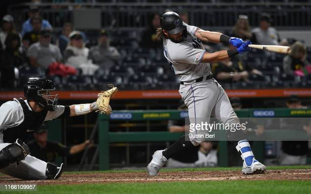 Jorge Alfaro of the Miami Marlins hits a two run RBI single to center field in the eighth inning during the game against the Pittsburgh Pirates at...