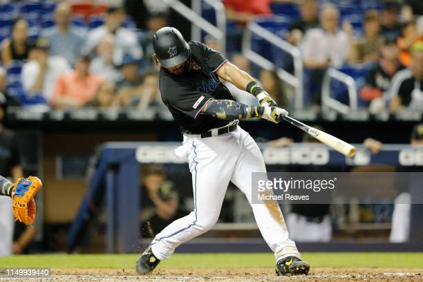Jorge Alfaro of the Miami Marlins hits a two-run home run against the New York Mets in the fifth inning at Marlins Park on May 17, 2019 in Miami,...