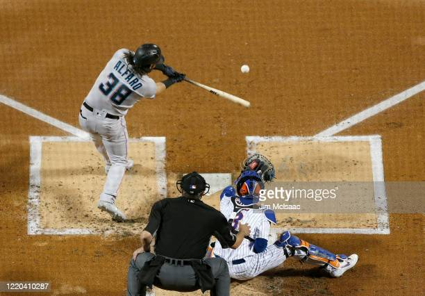 Jorge Alfaro of the Miami Marlins in action against the New York Mets at Citi Field on September 24, 2019 in New York City. The Mets defeated the...