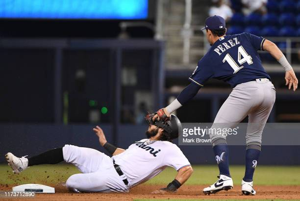 Jorge Alfaro of the Miami Marlins is tagged in the face while caught stealing second base by Hernan Perez of the Milwaukee Brewers in the eighth...