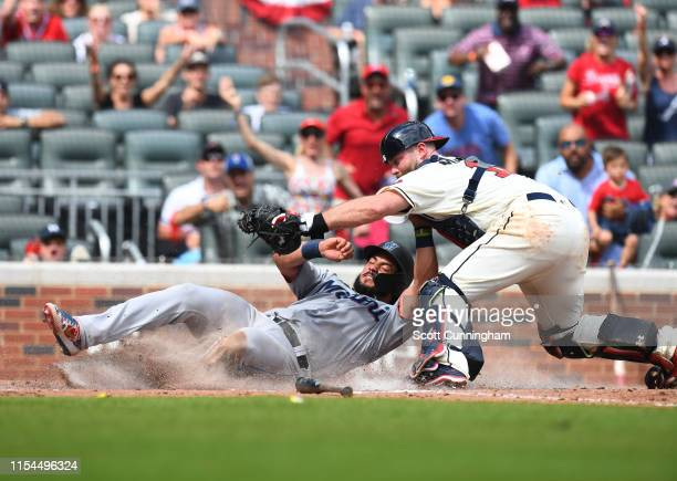 Jorge Alfaro of the Miami Marlins is tagged out at home during the ninth inning by Brian McCann of the Atlanta Braves at SunTrust Park on July 7,...