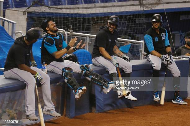 Jorge Alfaro of the Miami Marlins laughs with Jesus Aguilar, Francisco Cervelli and Miguel Rojas during summer workouts at Marlins Park on July 08,...