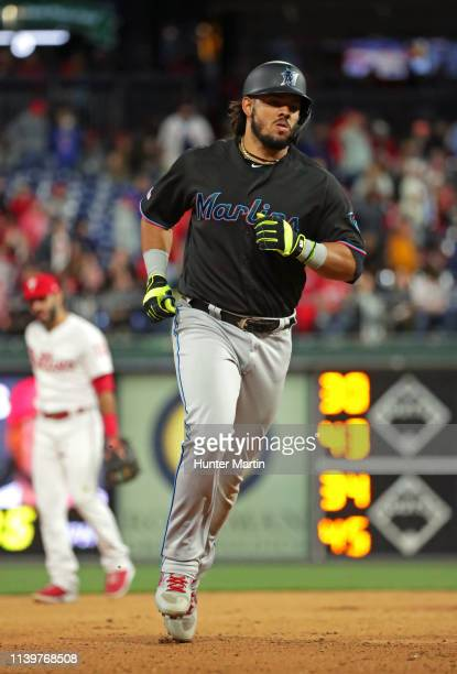 Jorge Alfaro of the Miami Marlins rounds the bases after hitting a tworun home run in the seventh inning during a game against the Philadelphia...