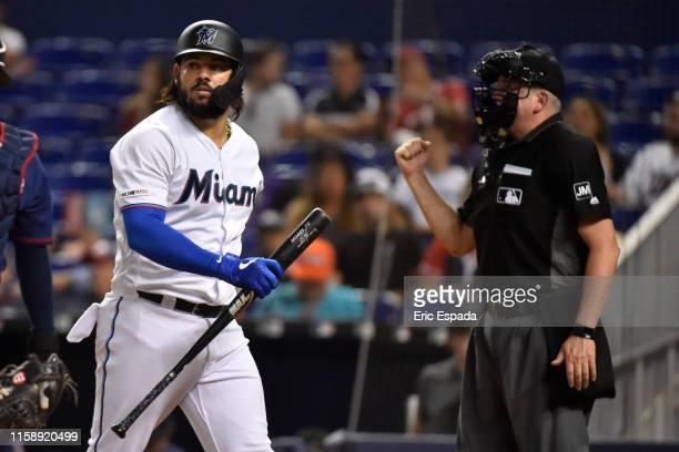 Jorge Alfaro of the Miami Marlins walks back to the dugout after striking out in the third inning against the Minnesota Twins at Marlins Park on July...