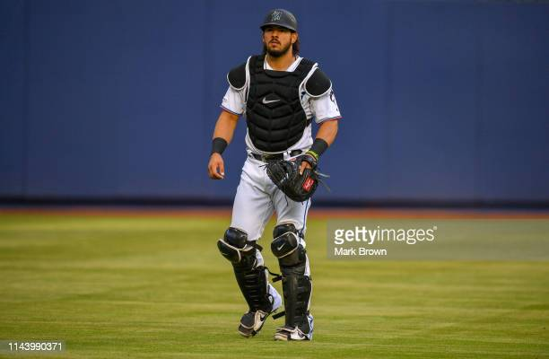 Jorge Alfaro of the Miami Marlins warming up before the game against the Chicago Cubs at Marlins Park on April 17 2019 in Miami Florida