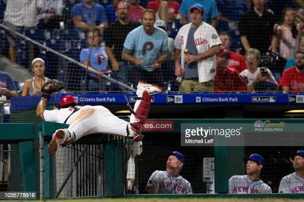 Jorge Alfaro of the Philadelphia Phillies catches a foul ball hit by Amed Rosario of the New York Mets in the top of the third inning at Citizens...