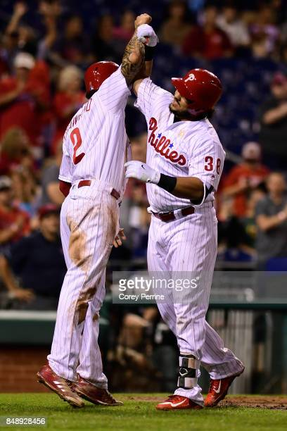 Jorge Alfaro of the Philadelphia Phillies celebrates his tworun homer with teammate JP Crawford against the Oakland Athletics during the sixth inning...