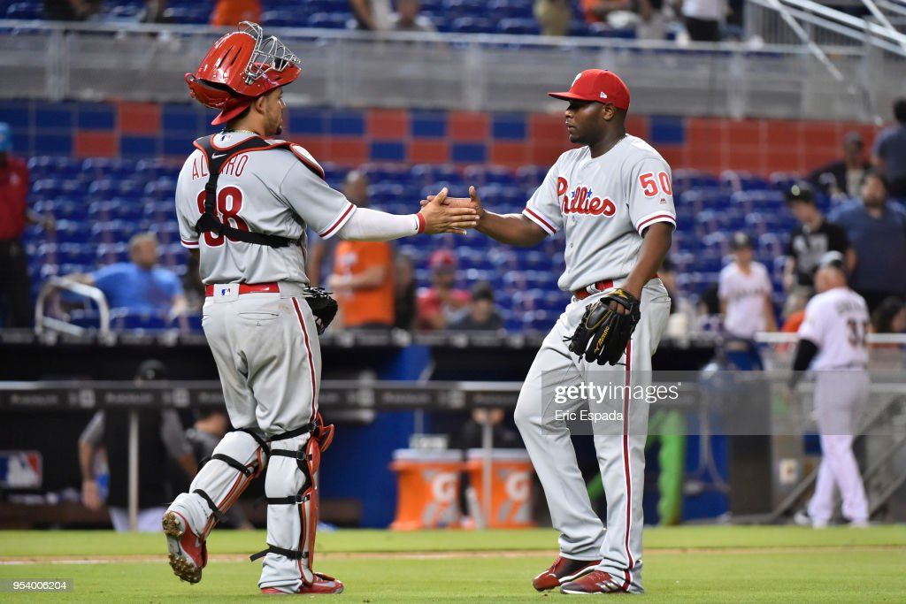 Jorge Alfaro #38 of the Philadelphia Phillies congratulates pitcher Hector Neris #50 after defeating the Miami Marlins at Marlins Park on May 2, 2018 in Miami, Florida.