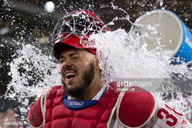 Jorge Alfaro of the Philadelphia Phillies has water poured on him after the game against the New York Mets at Citizens Bank Park on September 18,...