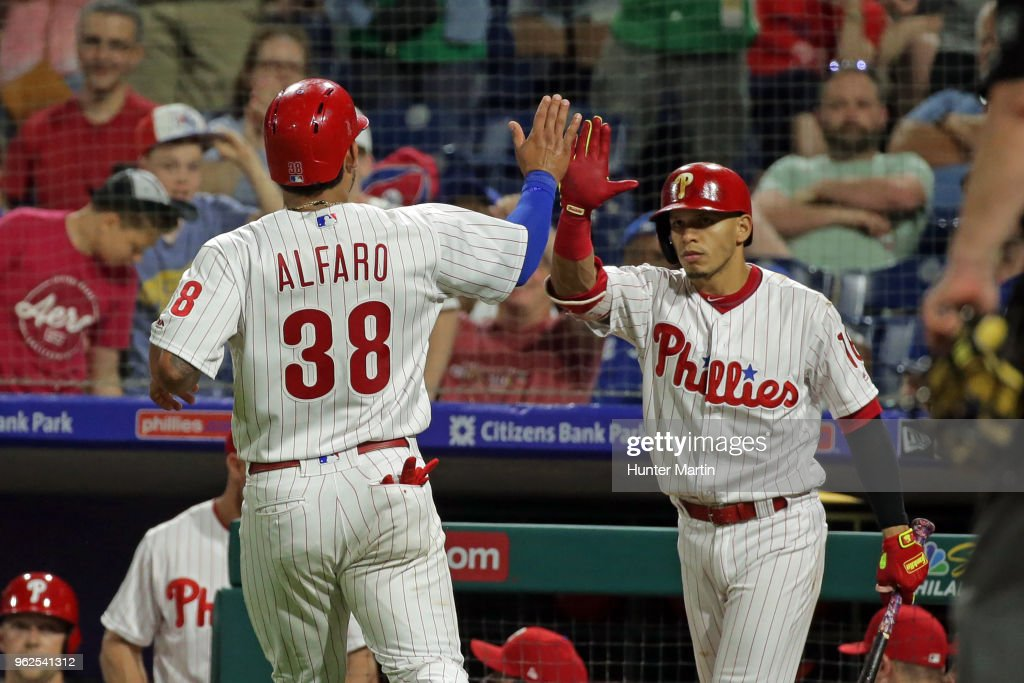 Jorge Alfaro #38 of the Philadelphia Phillies high-fives Cesar Hernandez #16 after scoring a run on a wild pitch in the ninth inning during a game against the Toronto Blue Jays at Citizens Bank Park on May 25, 2018 in Philadelphia, Pennsylvania. The Blue Jays won 6-5.