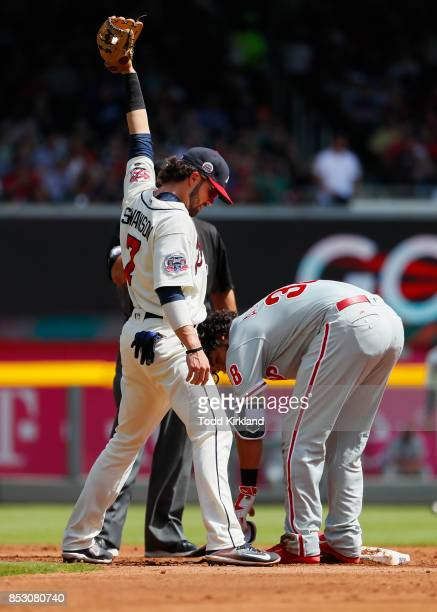 Jorge Alfaro of the Philadelphia Phillies is tagged out by Dansby Swanson of the Atlanta Braves attempting to advance to second in the third inning...