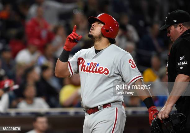 Jorge Alfaro of the Philadelphia Phillies points skyward after hitting a two run home run during the fifth inning of a baseball game against the San...