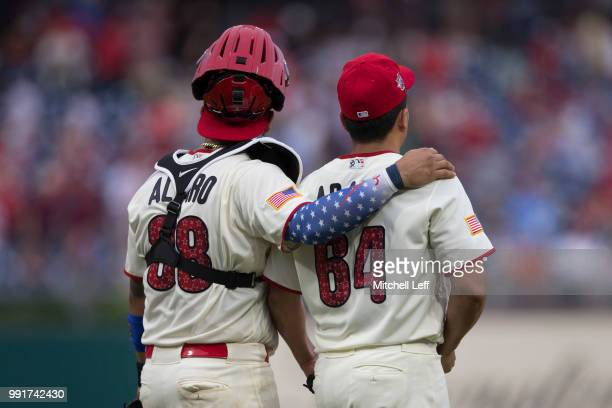Jorge Alfaro of the Philadelphia Phillies puts his arm around Victor Arano after the game against the Baltimore Orioles at Citizens Bank Park on July...