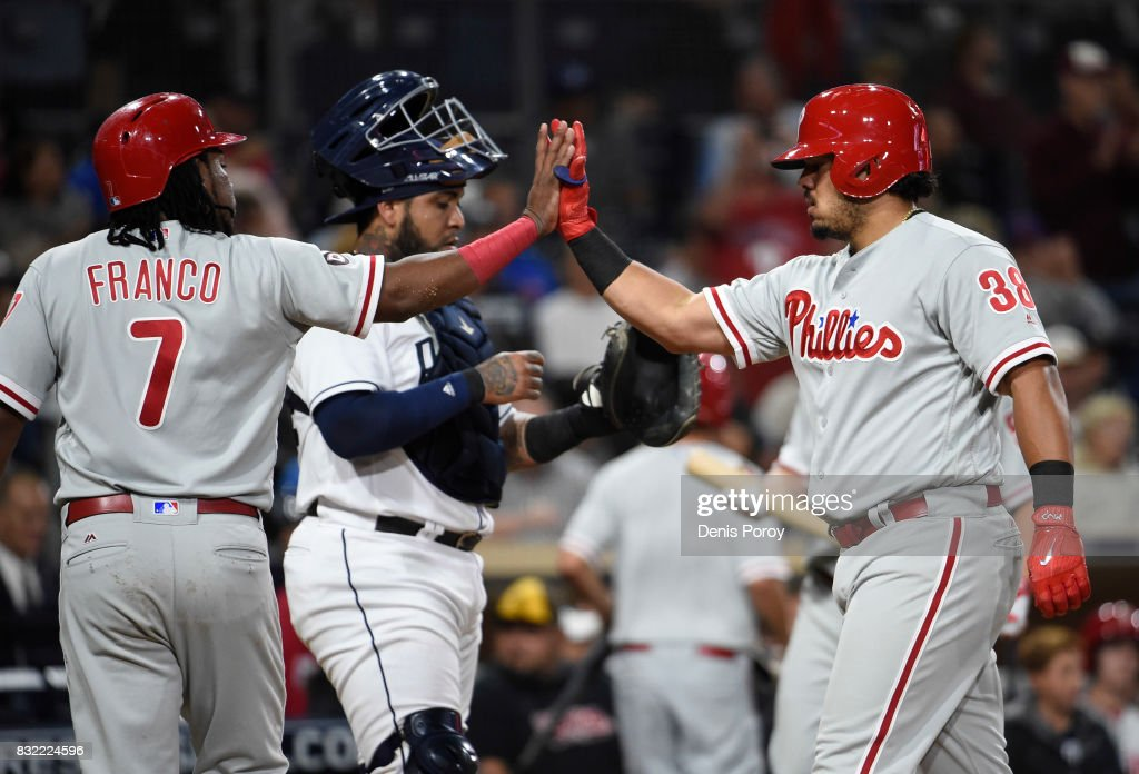Jorge Alfaro #38 of the Philadelphia Phillies, right, is congratulated by Maikel Franco #7 after hitting a two run home run during the fifth inning of a baseball game against the San Diego Padres at PETCO Park on August 15, 2017 in San Diego, California.