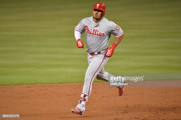 Jorge Alfaro of the Philadelphia Phillies rounds second base after hitting a home run in the second inning against the Miami Marlins at Marlins Park...