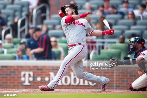 Jorge Alfaro of the Philadelphia Phillies swings and knocks his helmet off while hitting against the Atlanta Braves at SunTrust Park on September 23...