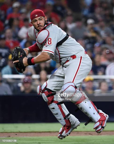 Jorge Alfaro of the Philadelphia Phillies throws out Franmil Reyes of the San Diego Padres during the eighth inning of a baseball game at PETCO Park...