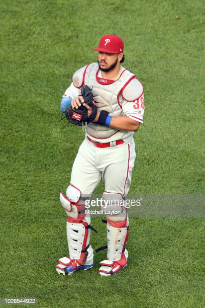 Jorge Alfaro of the Philadelphia Phillies warms up before a baseball game against the Washington Nationals at Nationals Park on August 22 2018 in...