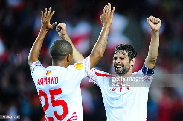 Jorge Andujar Moreno 'Coke' of Sevilla FC celebrates with his team mate Mariano Ferreria of Sevilla FC after defeating Shakhtar Donetsk during the...
