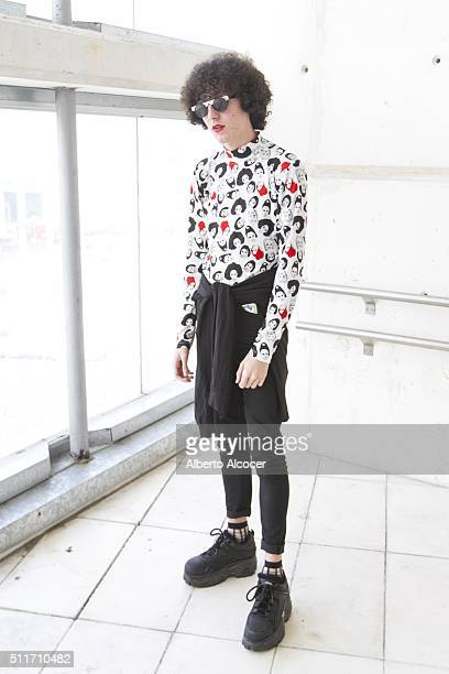 Jorge Ariza wears Buffalo boots HM pants Hosoi jersey Vintage sunglasses and Asos jacket during Mercedes Benz Fashion Week at Ifema on February 19...
