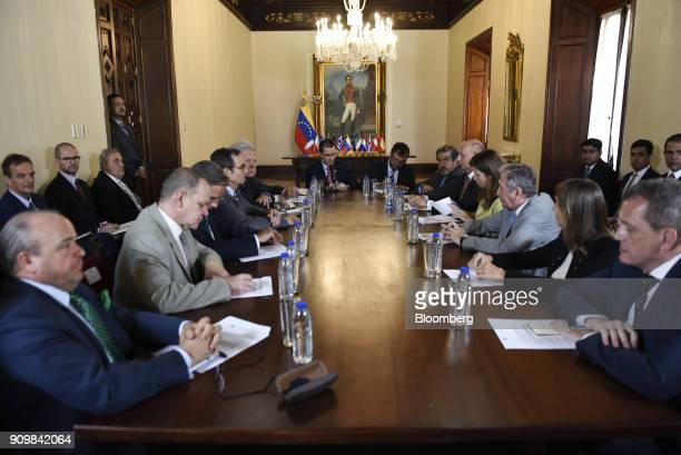 Jorge Arreaza Venezuela's foreign affairs minister center left speaks during a meeting with European Union ambassadors in Caracas Venezuela on...