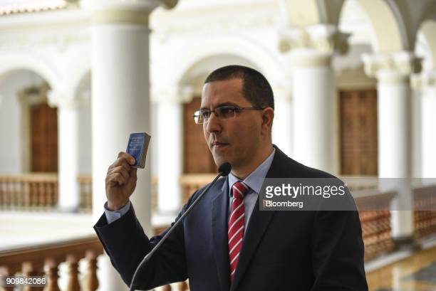 Jorge Arreaza Venezuela's foreign affairs minister holds a copy of the Venezuelan constitution during a news conference following a meeting with...