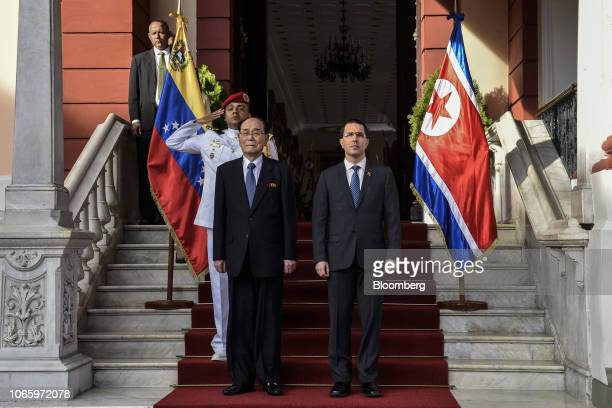 Jorge Arreaza Venezuela's foreign affairs minister right and Kim Yong Nam North Korea's deputy leader and ceremonial head of state observe a guard of...
