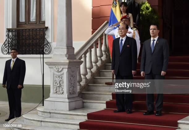 Jorge Arreaza Venezuela's foreign affairs minister right and Kim Yong Nam North Korea's deputy leader and ceremonial head of state stand after...