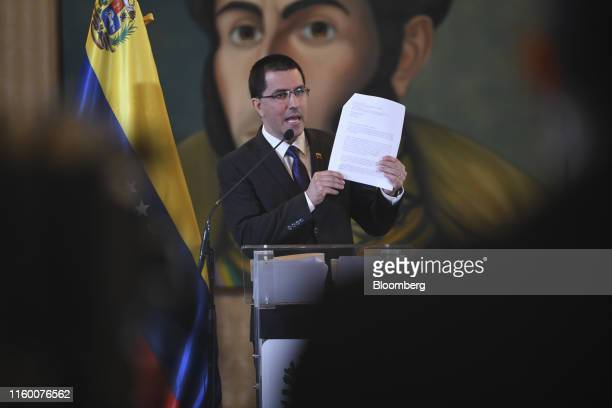 Jorge Arreaza Venezuela's foreign minister holds a copy of an email allegedly from the White House during a news conference in Caracas Venezuela on...