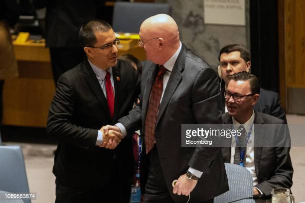 Jorge Arreaza Venezuela's foreign minister left shakes hands with Vasily Nebenzya Russia's permanent representative to the United Nations at a United...
