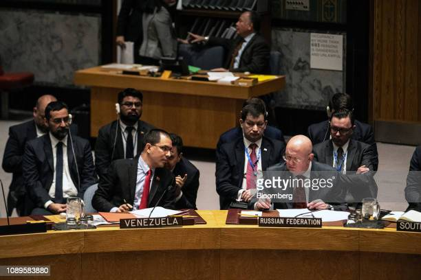Jorge Arreaza Venezuela's foreign minister left speaks with Vasily Nebenzya Russia's permanent representative to the United Nations at a United...
