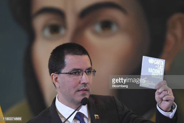 Jorge Arreaza Venezuela's foreign minister speaks while holding a copy of the Charter of the United Nations during a news conference in Caracas...