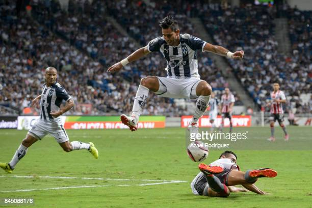 Jorge Benitez of Monterrey fights for the ball with Mario De Luna of Necaxa during the 8th round match between Monterrey and Necaxa as part of the...